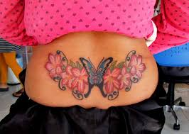 Lower Back Butterfly Tattoo With Flowers