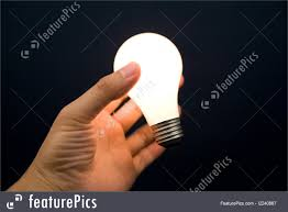 picture of holding a bright light bulb