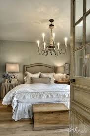 French Farmhouse Master Bedroom Rustic Chandelier Wooden Glass Panel Doors And Simple Accessories