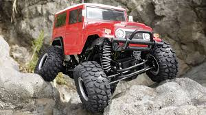 RC Toyota Land Cruiser   DudeIWantThat.com 58519 Tamiya Toyota Bruiser 110th Rc Kit Radio Control 110 Truck Toyota Hilux Rn36 Rctwister Tamiya Highlift Electric 4x4 Scale Truck Kit Tam58397 Venture Fj Cruiser Mystery Vehicle Big Squid Axial Scx10 Crawler Hillux Body Crawlers Tundra High Lift Brushed Model Car 4x4 Vintage 1981 Sold Antique Toys For Sale Builds A Modern Fullsize Bruiser Tamiyablog Traxxas Kyle Busch Race Vxl 7321 Out Of The Box Radio Shack Offroad Monsters Pickup Has Disco Lights Nostalgia Kicks In