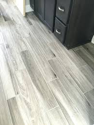 tiles newly installed gray weathered wood plank tile flooring