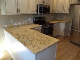 Backsplash Ideas White Cabinets Brown Countertop by White Cabinets Dark Granite Beige Tile Floor Wonderful Home Design