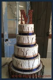 Rustic Textured Wedding Cake With Burlap Ribbon And Chocolate Sticks Twigs