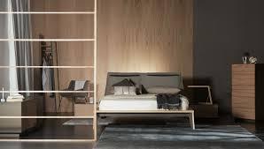 ein modernes schlafzimmer mit viel holz al2