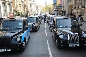 Black cab drivers blockade Whitehall in a protest against Uber