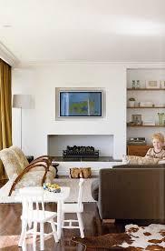 wohnzimmer mit fernsehgerät über dem bild kaufen