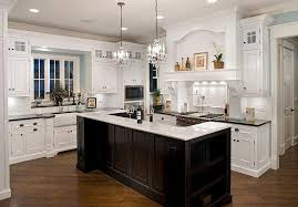 classic led lights in the kitchen design with chandelier above