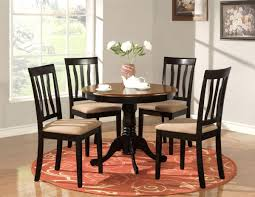 simple dining room design with round wood dining room table light