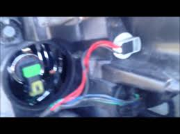 how to change chevy impala headlight bulb