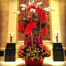 Crimson Chinese New Year flowers in the lobby of Four Seasons Hotel