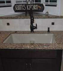 kohler langlade sink in sandbar with bellera faucet in orb sinks