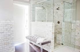 bathroom white brick tiles small bathroom upholstered bench half