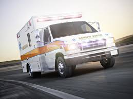 Ambulance Running With Lights And Sirens A Street With Motion