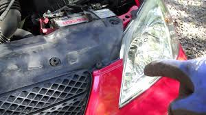 how to replace headl bulb left side toyota corolla years 2001