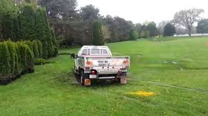 Pulling A Stuck Home Depot Truck With A Land Rover - YouTube