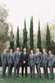 Picture Of Groomsmen Dressed In Grey Suits With Black Ties And The Groom To Stand Out