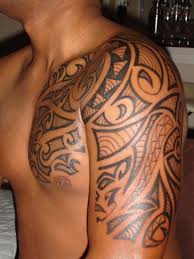 Hawaiian Tribal Tattoo On Man Chest And Left Half Sleeve