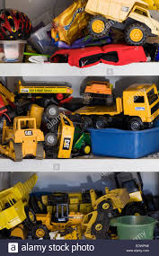 100 Trucks And Toys And Diggers For Use In The Garden Childrens Toys Stock