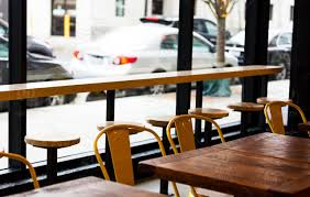 High Resolution Color Digital Photo Of A Row Rustic Restaurant Style Tables Vintage Chairs Next To Bar Seating By Window On City Street At Cafe