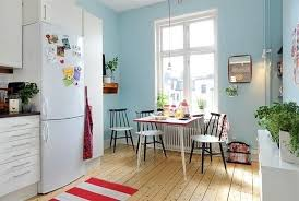 cool blue interior paint and colorful decorative accents summer