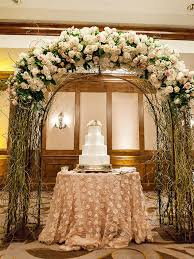 Repurpose The Wedding Arch After Ceremony To Create A Stunning Cake Display