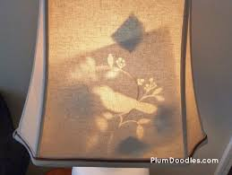 DIY Lamp Makeover With Peek A Boo Shade Lining Up Stencil On