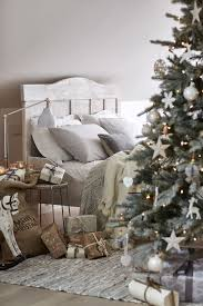 Christmas Bedroom Layer Natural Bedlinen With Throws In Soft Hues On A Rustic
