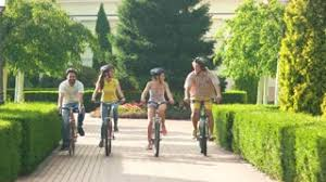 Four Happy Cyclists Enjoying Riding Bicycles Cheerful Group Of Friends Bikes In Park