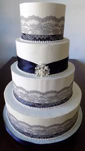4 Tier Buttercream Wedding Cake Decorated With Navy Blue Ribbons Grey Silver Lace