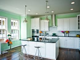 Green Transitional Kitchen Island With White Cabinet And Brown Floor