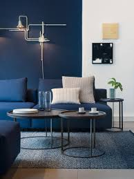 blue living room grey walls navy decor and orange accent wall
