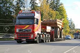 PARAINEN, FINLAND - OCTOBER 9, 2015: Volvo FH Hauls A Volvo BM.. The Worlds Largest Ming Dump Trucks Engineers World Truck Bodies Commercial Equipment Dejana 16 Yard Body Utility Top Benefits Of Hiring A Hauling Service Parainen Finland October 9 2015 Volvo Fh Hauls Bm Rigid Dump Truck Diesel Ming And Quarrying 793f Wei Jiang Transformers Metal Robot Wide Load High Quality Home Depot 12volt Kids Best Manufacturers 777 Grader D10 Dozer 773 Water Qld Omt187892