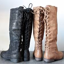 laced up weathered riding boots black weather and gray
