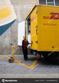 100 Truck Central Senior Worker Discharge DHL Parcels From Truck In Central Square
