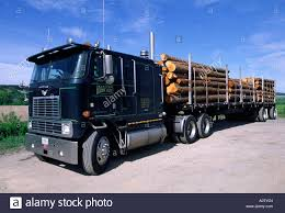 Truck Hauling Lumber Stock Photo: 3288019 - Alamy Us Lumber Group Llc Atlanta Ga Rays Truck Photos Fshlyrestored Smithmiller And Pup Trailer Flatbed Delivering Wood With A Forklift Youtube Trucks Gallery Ad Moyer Logging Truck Wikipedia An Old Dump Is Positioned In A Gravel Yard With Box Raised Up Seymour At Parade Editorial Photography Image Of Md 140 Lumber Crash Carroll County Times Transport Forestry Industry Stock Dubell Showroom Cporate Hq Medford Nj 2013 Gsl Kidney Kamp Show 1948 Pete N Trailer Fitting Mgs Store