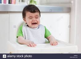 Baby Boy In High Chair, Crying Stock Photo: 280905362 - Alamy