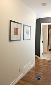 Sherwin Williams Creamy In A Dark Hallway With Benjamin Moore Gray Feature Wall Or Accent Kylie M Interiors Laminate Wood Flooring And Cloud White