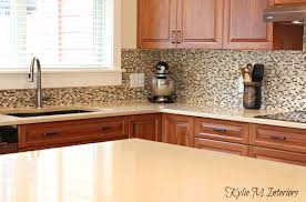 quartz countertops cherry kitchen cabinets small mosaic