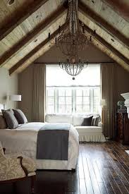 2 Tags Traditional Guest Bedroom With Interior Wallpaper Hardwood Floors Cathedral Ceiling Chandelier Exposed