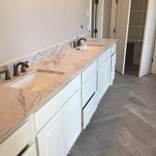 calcutta quartzite in master bathroom beautiful gray and
