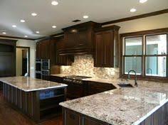 Kitchens With Dark Cabinets And Light Countertops by Moon White Granite Dark Kitchen Cabinets Kitchen Ideas