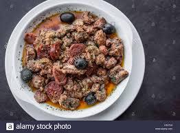 cuisine pau pica pau traditional portuguese spicy sauce pork and sausage tapas