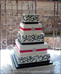 pink and black wedding cake with brooches