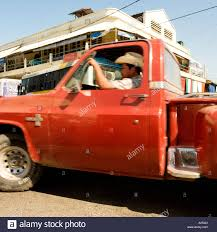 Mexican Man Wearing Cowboy Drives A Pick Up Truck Fast Around A ...