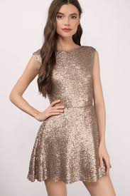 matte gold skater dress open back dress sparkly rose gold
