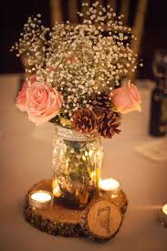 Stunning Rustic Mason Jar Centerpiece With Pine Cones Candles And Wooden Table Number