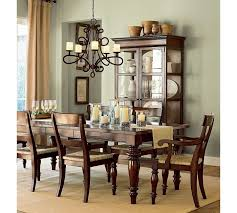 Wrought Iron Chandelier And Antique Wooden Dining Table For Luxury Room Ideas With