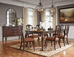 Gladdenville Brown 8 Pc Rectangular Dining Room Extension Table 6 Upholstered Side Chairs