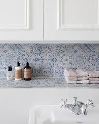 bathroom with blue mosaic tiled niche shelf transitional bathroom