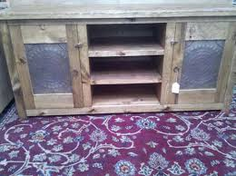 With A Rustic Pine Finish And Stamped Tin Doors The Metal TV Stand Offers Versatile Storage Country Style Hand Crafted From